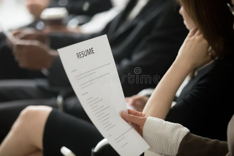 Multiracial business people waiting in queue preparing for job i stock photo