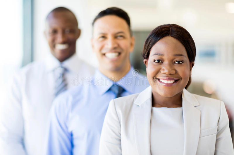 Multiracial business team. Group of multiracial business team standing in a row stock images
