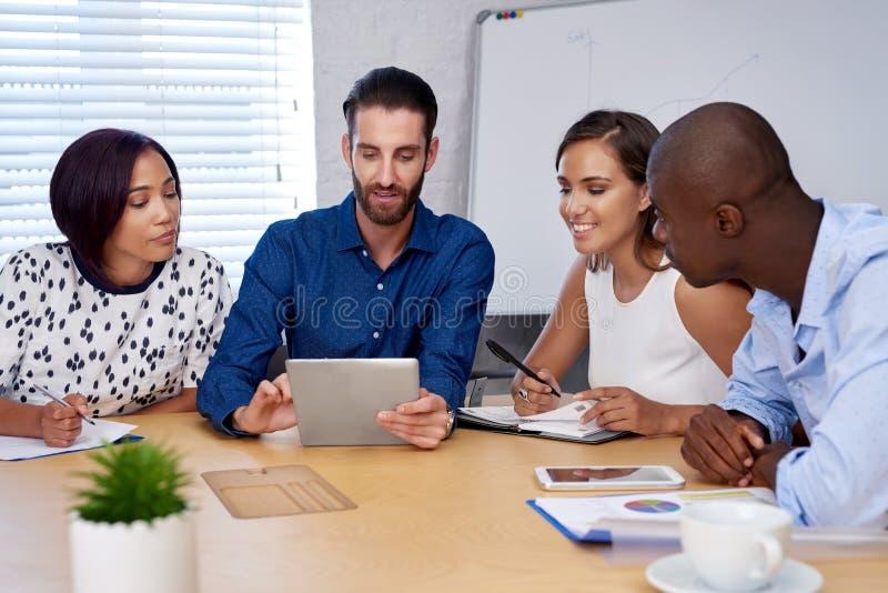 Multiracial business team meeting stock photography