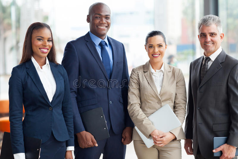 Multiracial business team. Portrait of multiracial business team in office royalty free stock photography