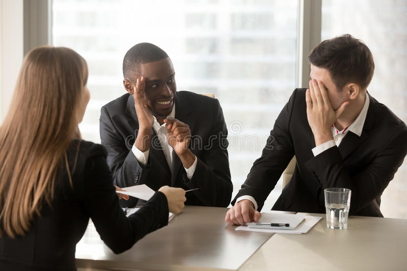 Multiracial businessmen hiding face with hands, secretly talking royalty free stock photos
