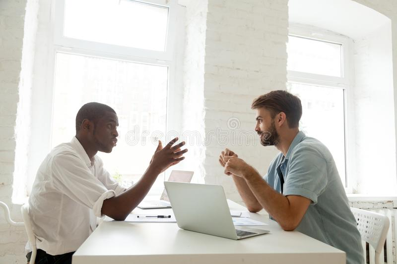 African-american and caucasian colleagues brainstorming new star royalty free stock image
