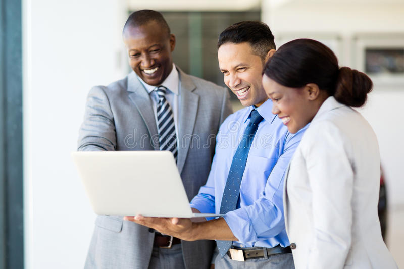 Multiracial businesspeople laptop computer. Successful multiracial businesspeople using laptop computer stock image