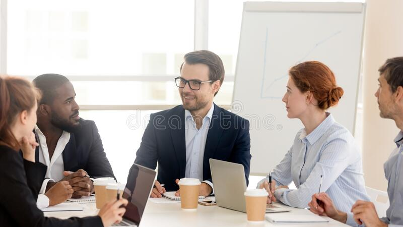 Multiracial team brainstorm cooperating at business office meeting stock photos