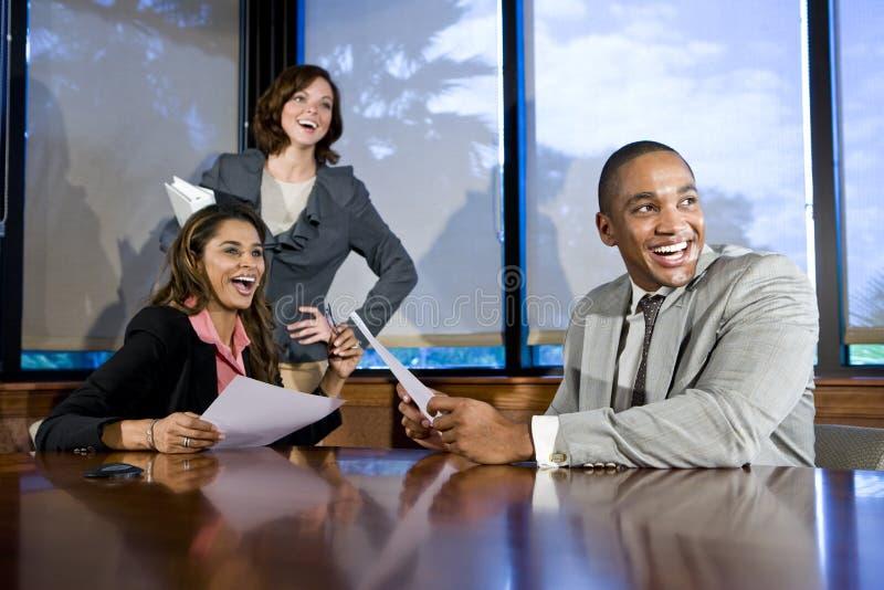 Multiracial businesspeople watching presentation stock photo