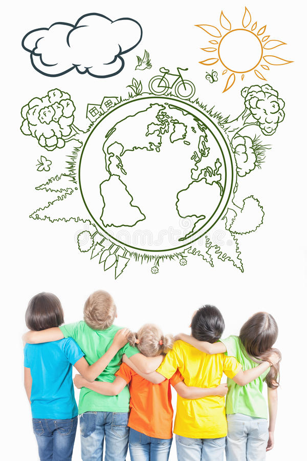 Multiracial children looking on clean, not polluted planet Earth stock images