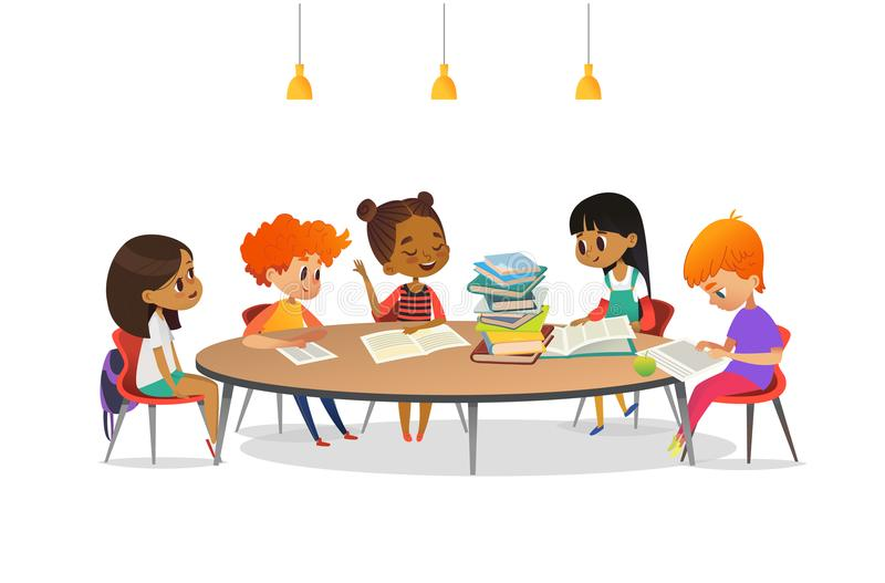Multiracial children sitting around round table with pile of books on it and listening to girl reading aloud. School stock illustration