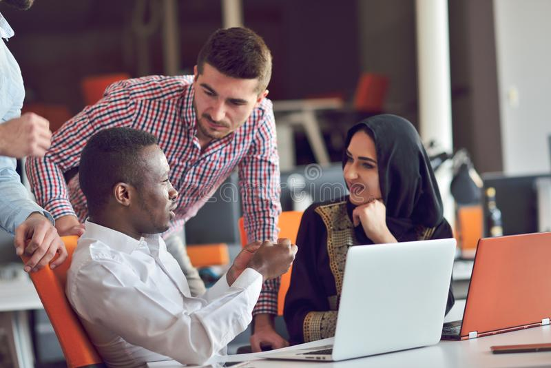 Multiracial contemporary business people working connected with technological devices like tablet and laptop. Talking together - finance, business, technology stock images