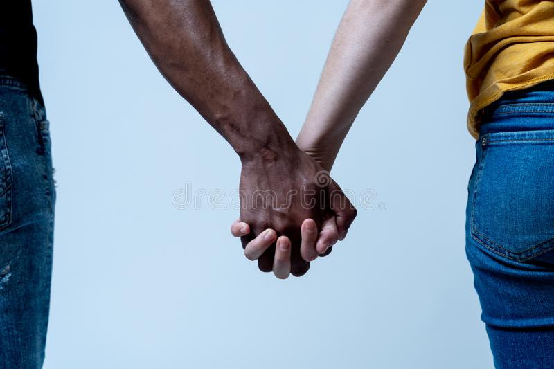 Races united for better world. Conceptual image of multiracial love and against racism stock photography