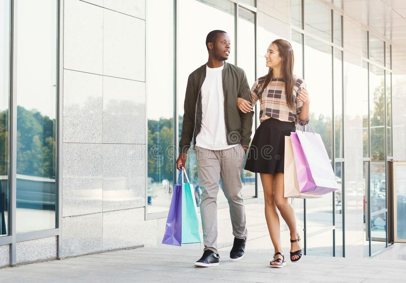 Multiracial couple shopping together stock photo