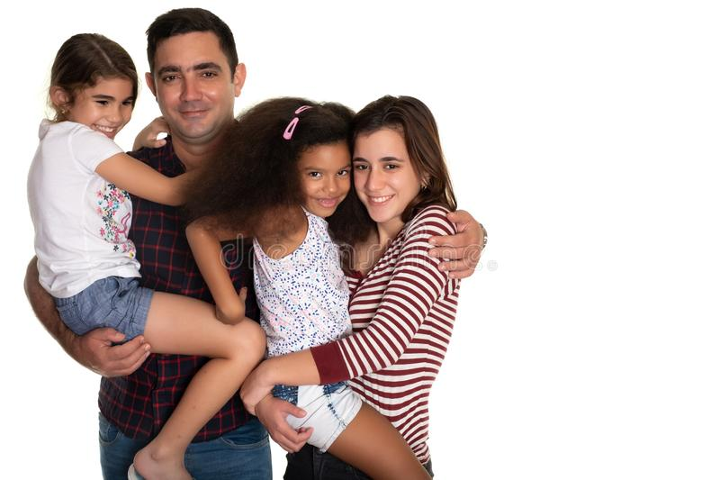 Multiracial family, Hispanic father with his three mixed race daughters stock photos