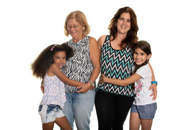 Multiracial family - Mom and grandmother hugging their mixed rac stock image
