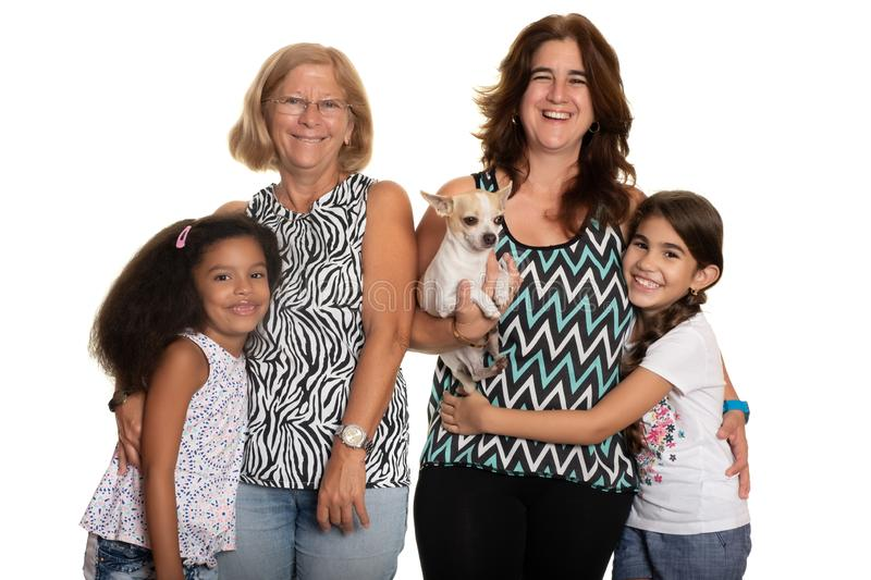 Multiracial family - Mom and grandmother hugging their mixed race children royalty free stock image