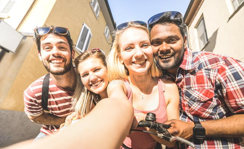 Multiracial friends taking selfie outdoors - Happy friendship concept with young students having fun together - Millenial people royalty free stock images