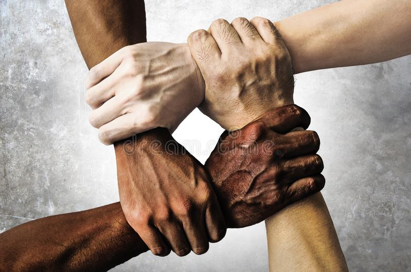 Multiracial group with black african American Caucasian and Asian hands holding each other wrist in tolerance unity love and anti stock photos