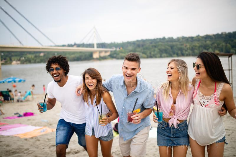 Multiracial group of friends enjoying a day at beach. royalty free stock photography