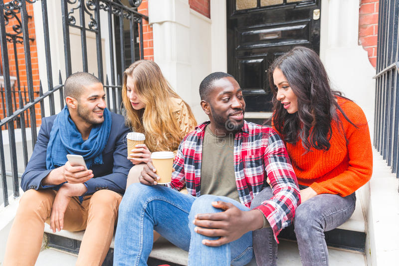 Multiracial group of friends having fun together in London stock image