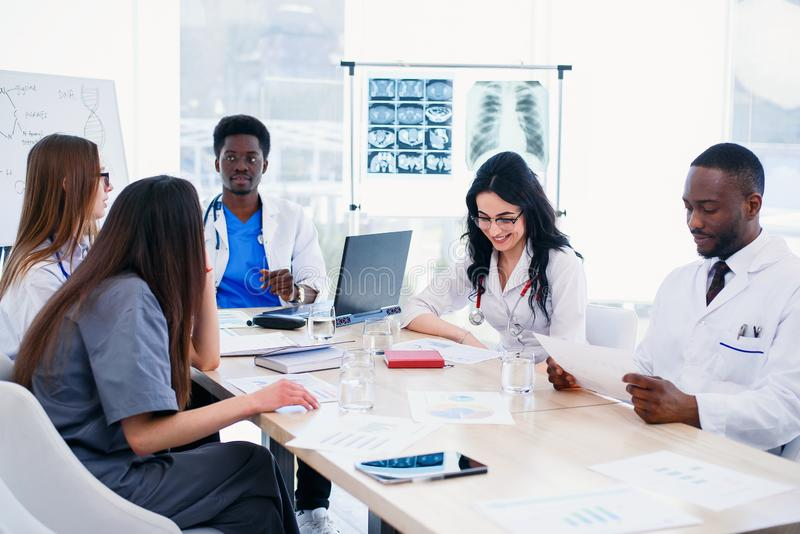 Multiracial group of professional medical doctors have a meeting at conference room in hospital. The team of young. Multiracial group of five professional royalty free stock image