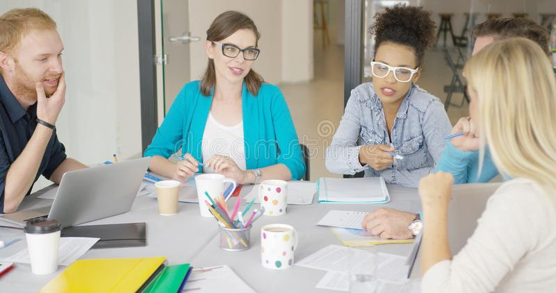 Young women and men working in office royalty free stock photo