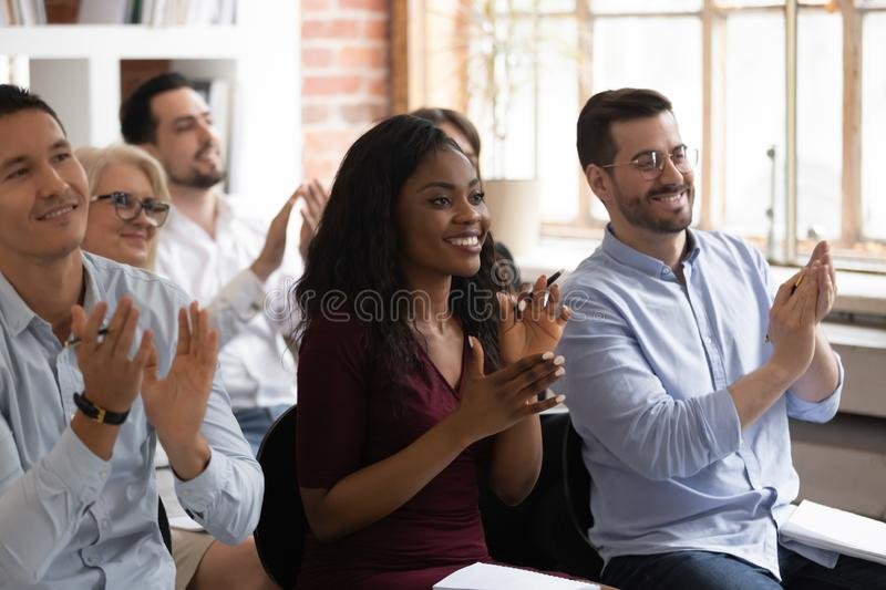 Multiracial happy business audience people applaud thank for workshop presentation. Multiracial happy african and caucasian business team audience people applaud royalty free stock photo