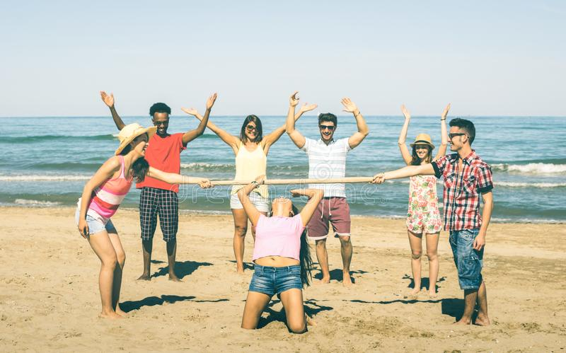 Multiracial happy friends group having fun together with limbo g royalty free stock image