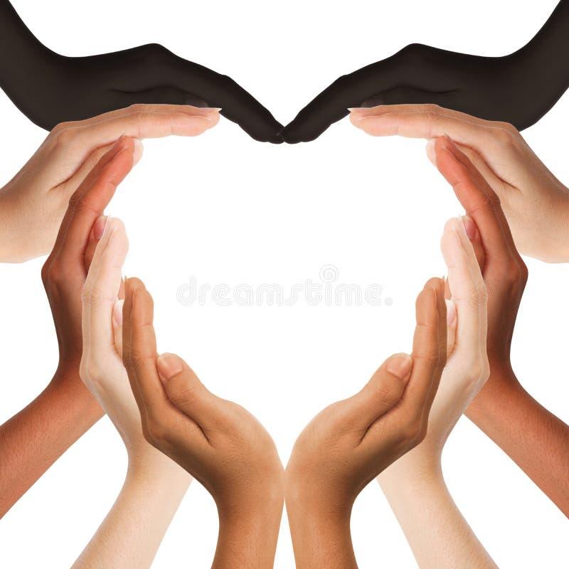 Multiracial mänskliga händer som gör en hjärtaform royaltyfria bilder