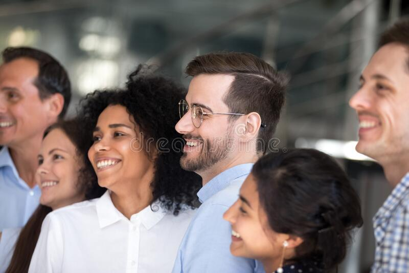 Multiracial colleagues smile posing for group picture together stock image