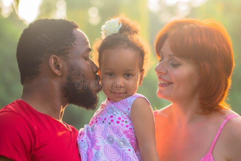Multiracial mixed family concept. stock photos