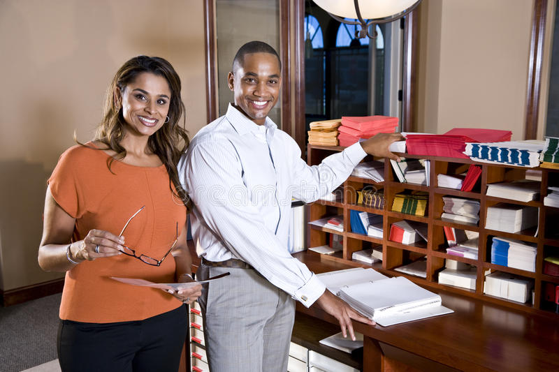 Multiracial office workers working on documents royalty free stock photos