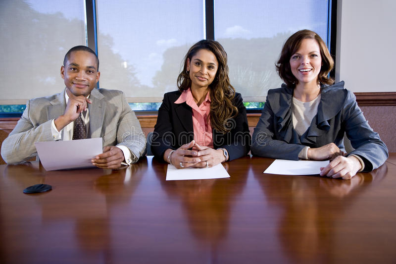 multiracial panel tre för businesspeople arkivbilder