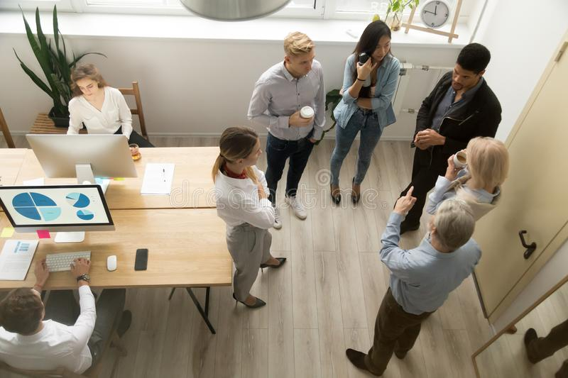 Multiracial office people of different age working talking, top stock images