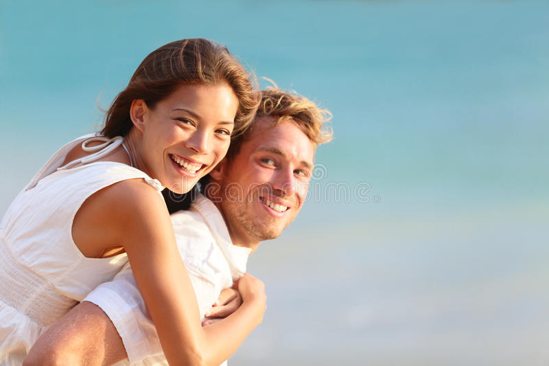 Multiracial people: Happy couple piggyback royalty free stock photography
