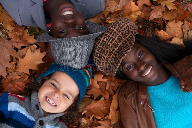Multiracial portrait of 3 kids stock photos