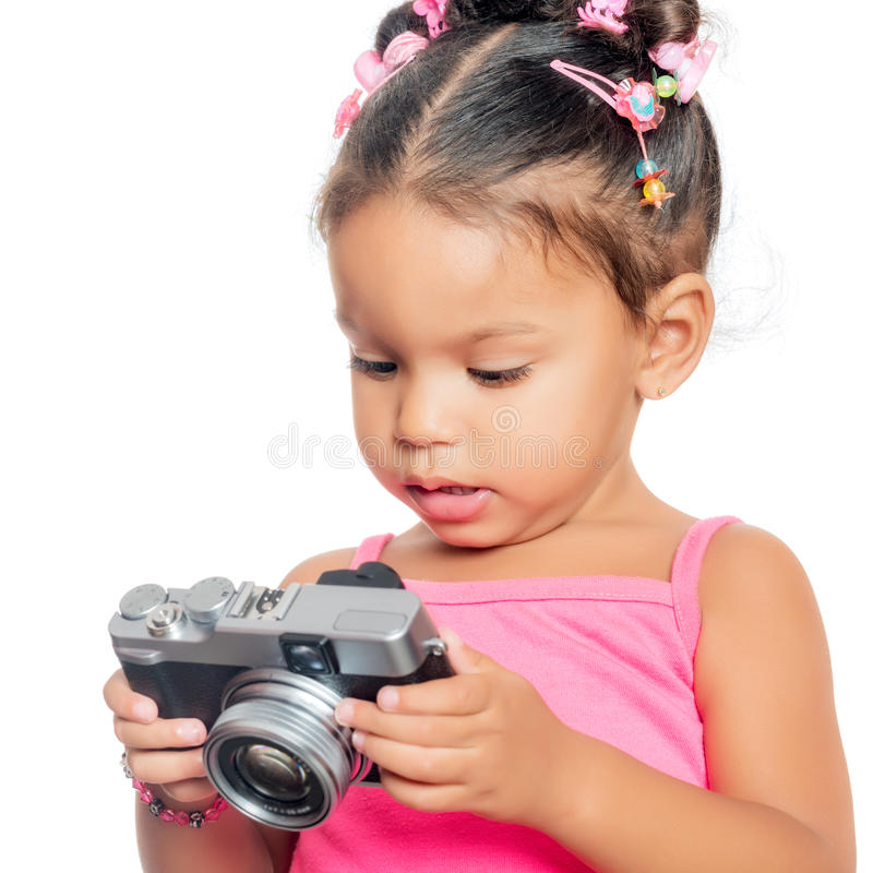 Multiracial small girl holding a compact camera. On white royalty free stock photography