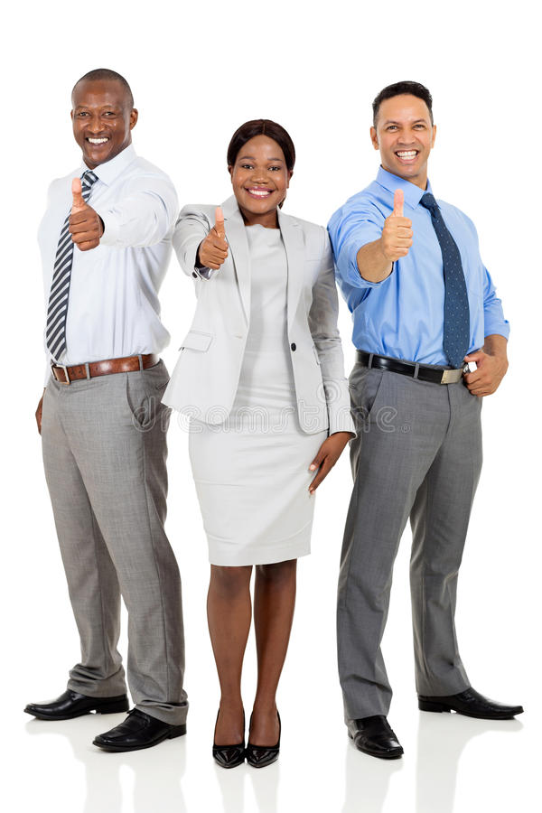 Multiracial team thumbs up. Multiracial business team giving thumbs up isolated on white royalty free stock photos
