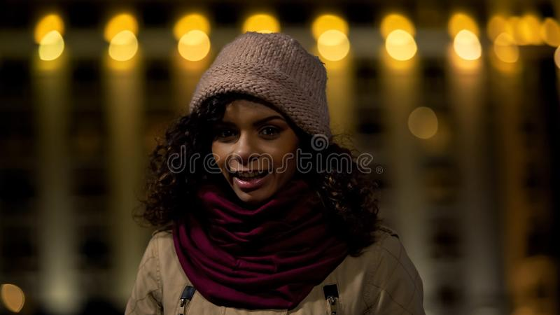 Multiracial teen girl smiling and posing for camera, exchange students program royalty free stock photos