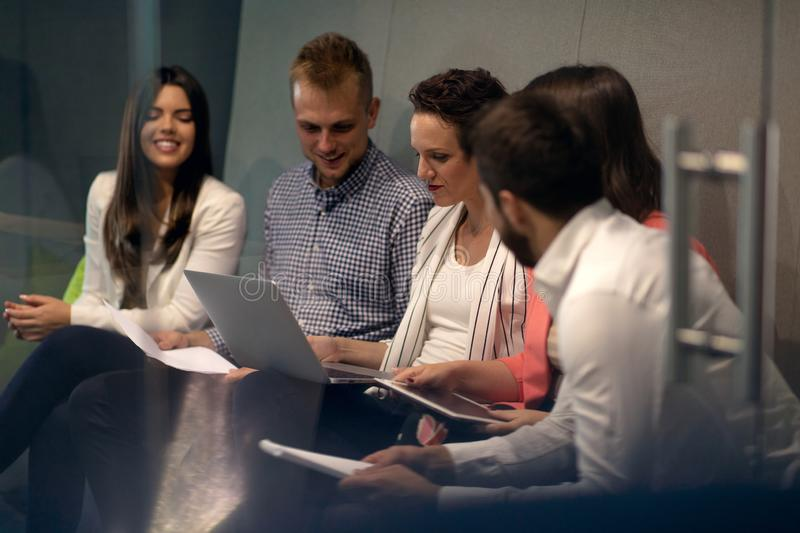 Multiracial young creative people in modern office. Group of young business people are working together with laptop stock image