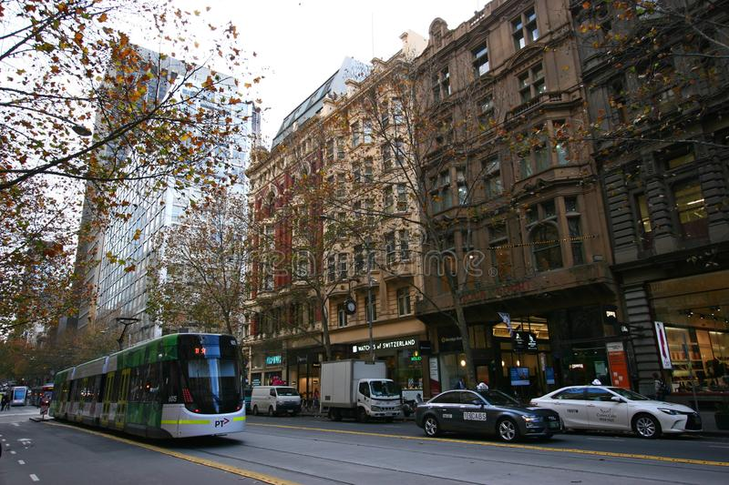 Multistory classic and historic cityscape and modern public tramway in Melbourne CBD, Victoria, Australia. Neo-classical and decorated exteriors of heritage royalty free stock photography