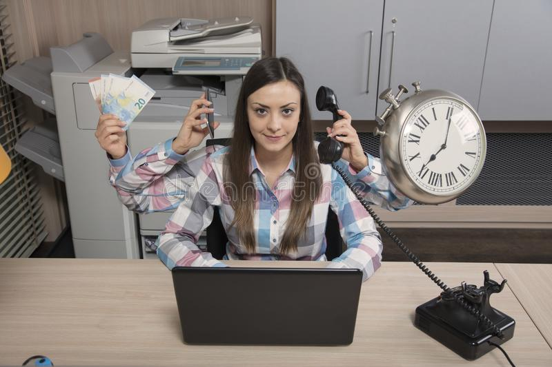Multitasking business woman is a real miracle at work stock images