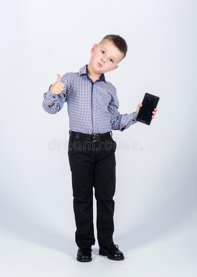 Multitasking. Businessman. Office life. Conversation. small boy with mobile phone. confident child has business start up royalty free stock photography