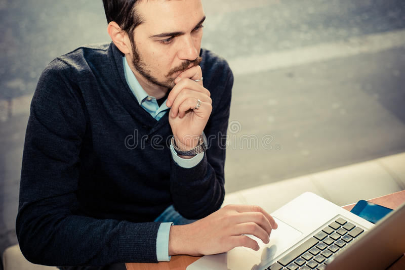 Multitasking man using tablet, laptop and cellhpone. Connecting wifi stock photo