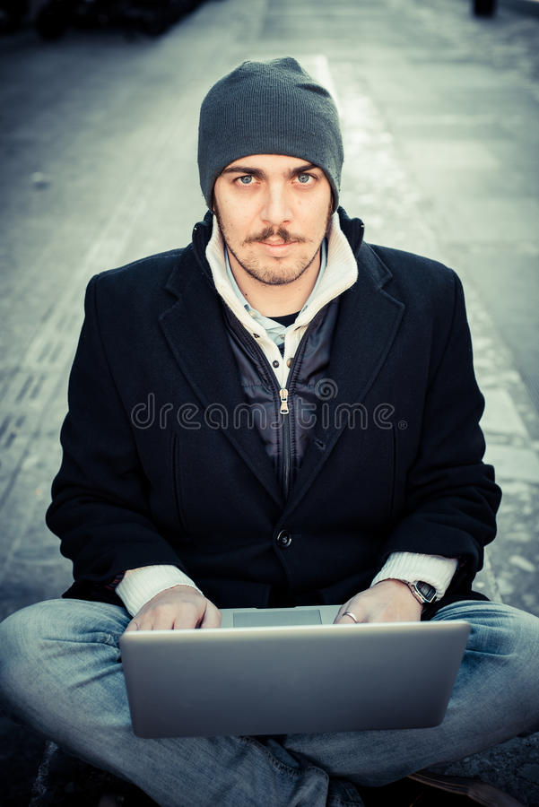 Download Multitasking Man Using Tablet, Laptop And Cellhpone Stock Photo - Image: 36266002