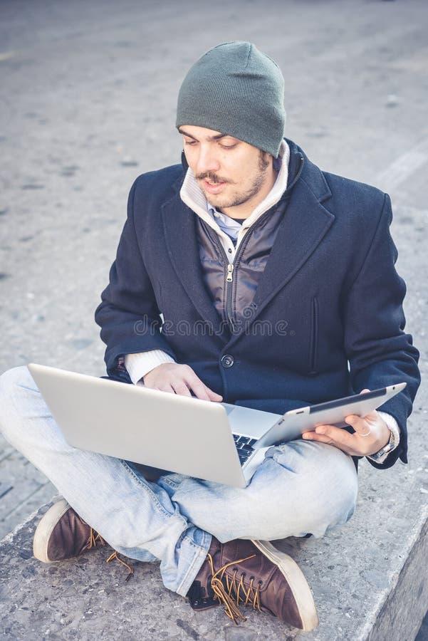 Download Multitasking Man Using Tablet, Laptop And Cellhpone Stock Image - Image: 36266159