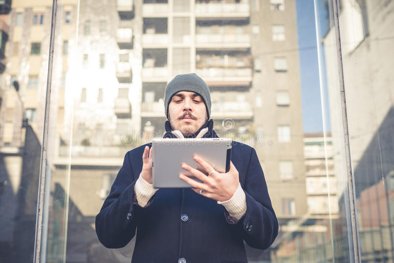 Download Multitasking Man Using Tablet, Laptop And Cellhpone Stock Photo - Image: 36266420