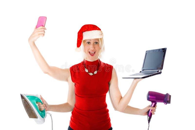 Multitasking Santa Claus arkivfoton