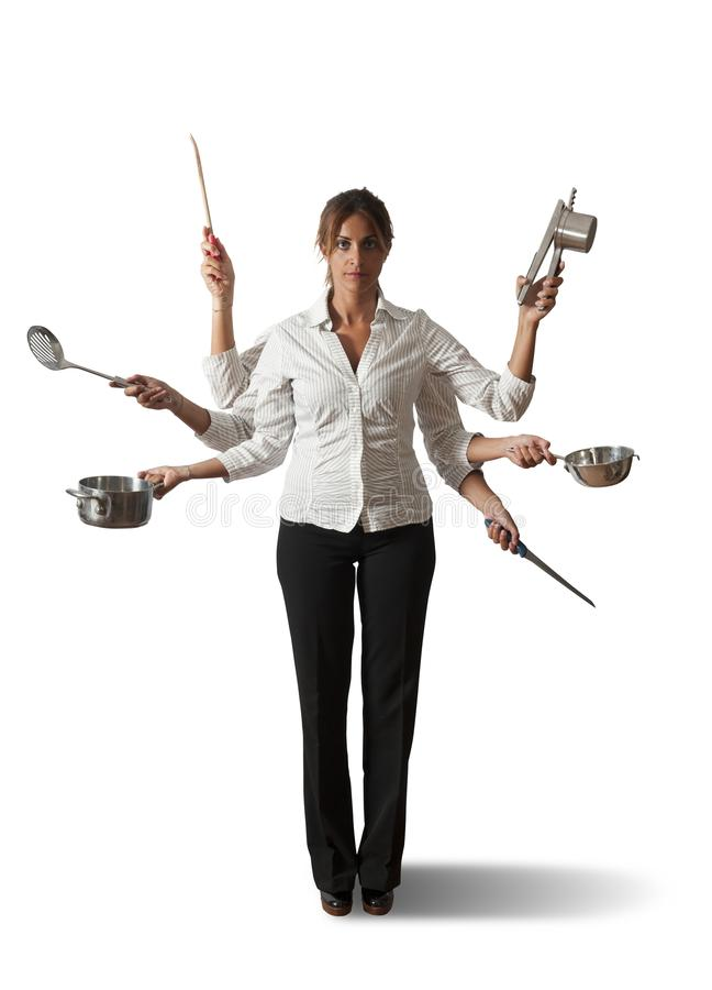 Multitasking woman in kitchen stock photos