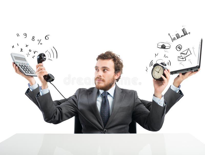 Multitaskingaffärsman arkivfoton
