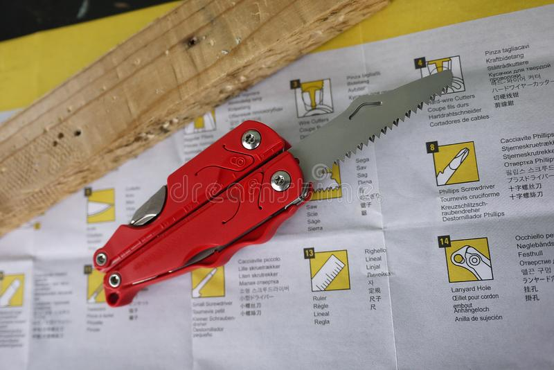 Multitool with a variety of devices. In this device, in the form of a conventional penknife you have a lot of items. Knife, saw, scissors, several screwdrivers royalty free stock images