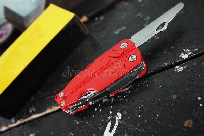 Multitool with a variety of devices. In this device, in the form of a conventional penknife you have a lot of items. Knife, saw, scissors, several screwdrivers stock image