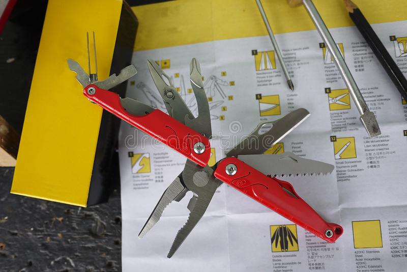 Multitool with a variety of devices. In this device, in the form of a conventional penknife you have a lot of items. Knife, saw, scissors, several screwdrivers stock photography
